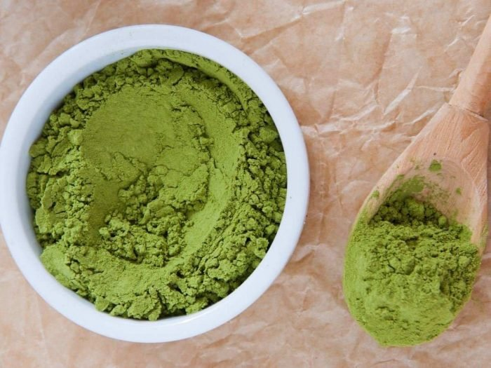 A bowl of matcha powder on a table