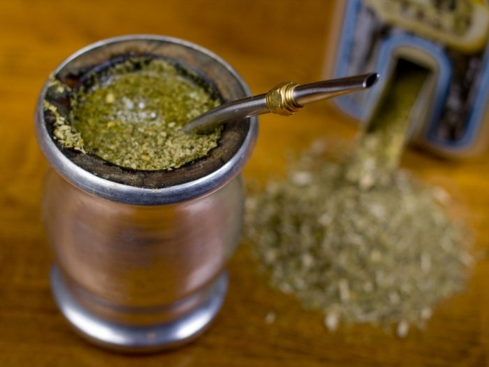 Yerba mate tea mixed in water kept atop a wooden table