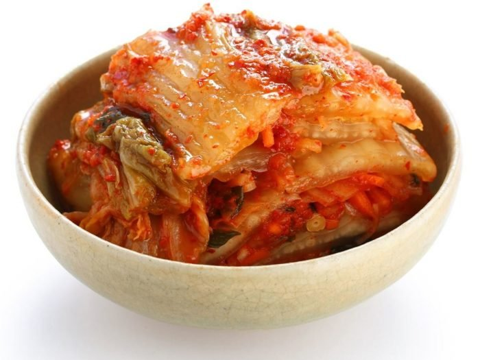 A bowl of kimchi on a white background