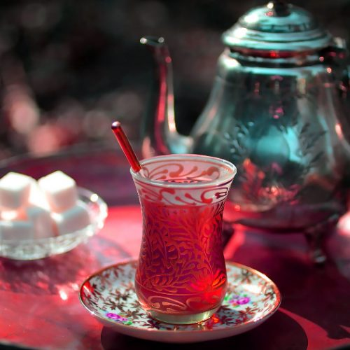 A teapot of Azerbaijani Turkish tea, traditional glass, and sugar on a tray