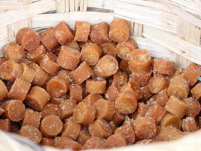 Brown sugar cubes in a basket.