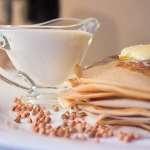 Buckwheat crepes with ingredients in the background