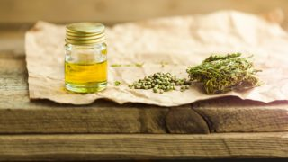 Medicinal cannabis with oil extract in bottle