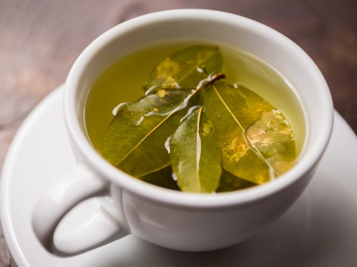 A white cup filled to the brim with coca tea
