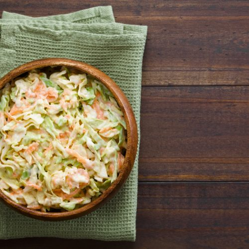 Coleslaw made of freshly shredded white cabbage and grated carrot with homemade mayonnaise-based salad dressing