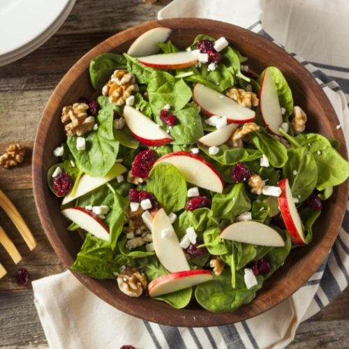 apple cranberry walnut salad in a wooden bowl