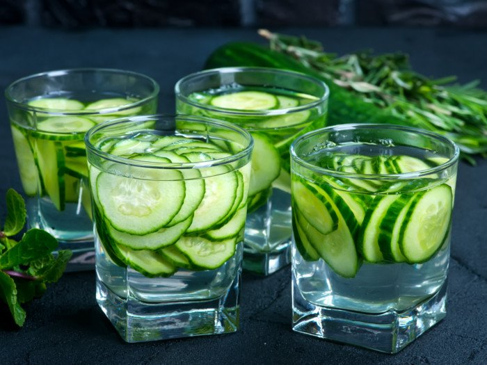 4 glasses filled with cucumber water