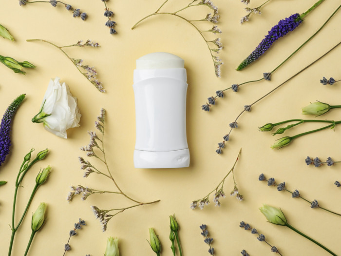 Flatline picture of a deodorant stick surrounded by lavender flowers.