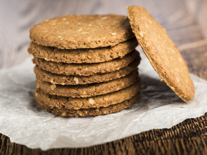 A stack on digestive biscuits on a counter