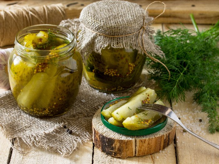 Marinated pickle with cucumber, dill, and garlic on the kitchen table