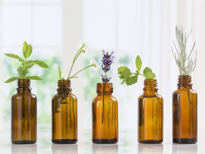 5 bottles containing different type of herbs