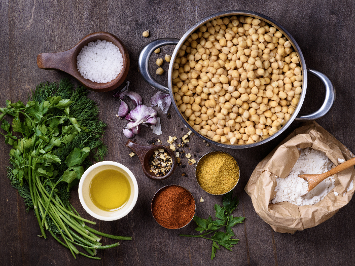 Chickpea in a pan with ingredients for cooking falafel, vegetarian healthy dieting.