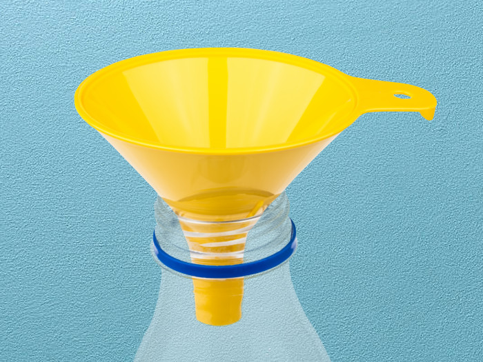 Close-up of a yellow funnel placed on top of a plastic bottle on a light blue background.