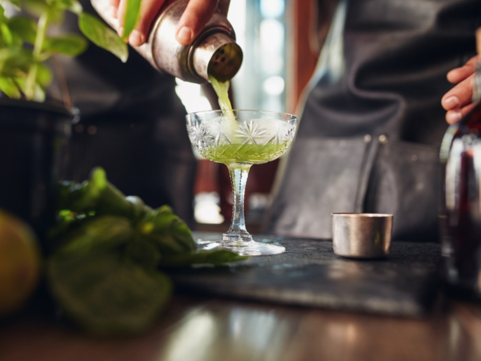 A person making an exotic cocktail
