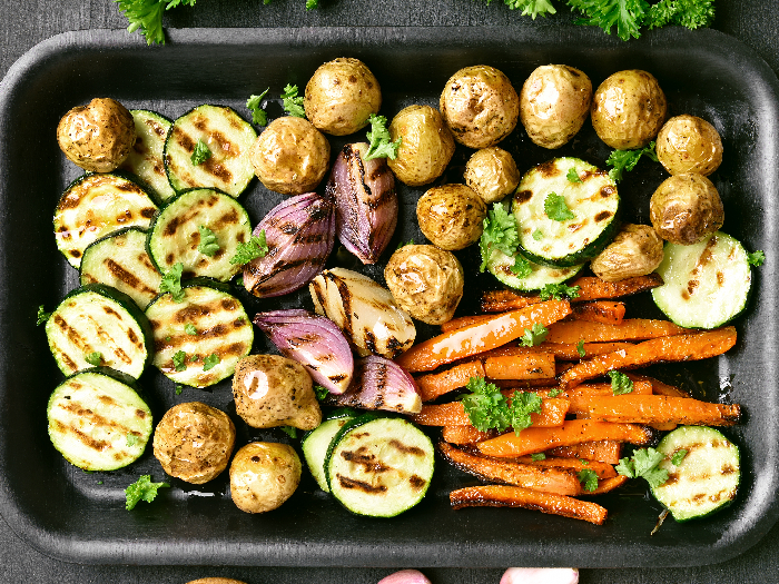 Grilled vegetables in a baking tray, top view