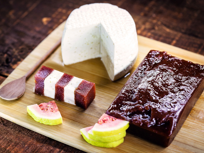 Guava paste, cheese and guava slices on a wooden platter
