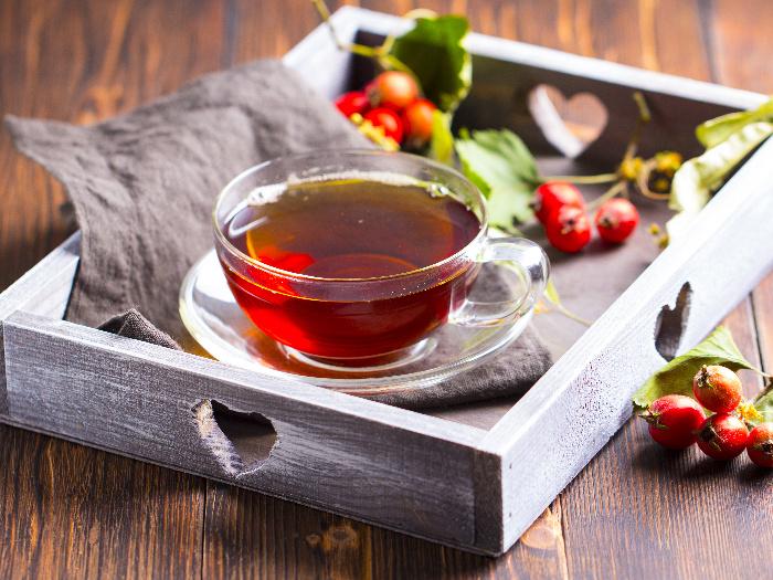 Hawthorn tea in a teacup with hawthorn on a tray
