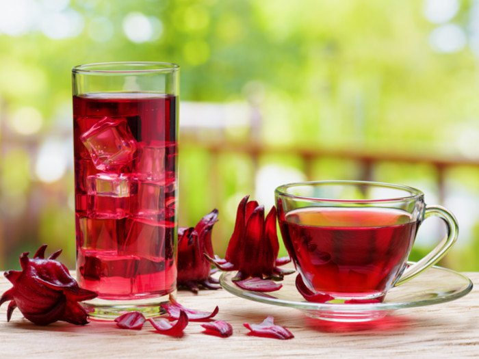 Hot and cold hibiscus tea on a table
