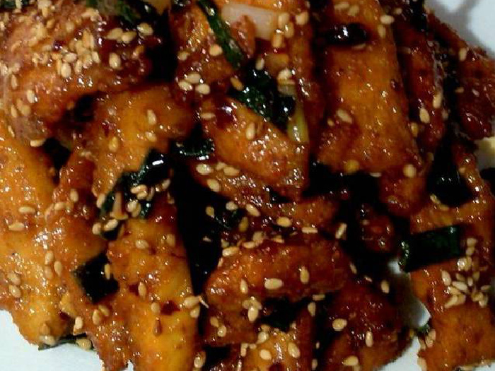 A close up shot of honey chili chicken