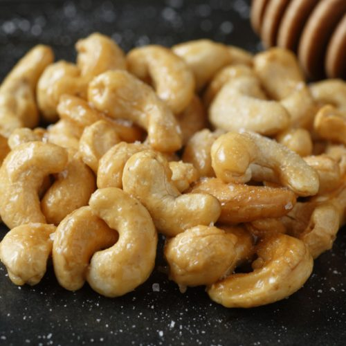 A closeup of honey roasted cashews on a kitchen table