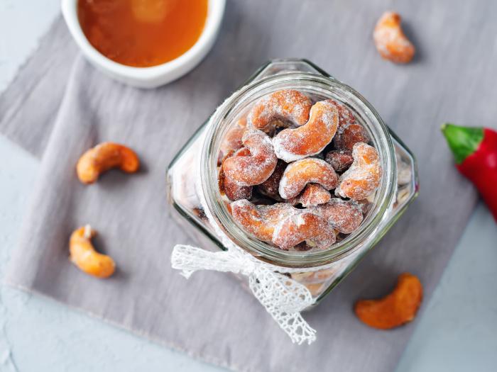Honey roasted cashews on a grey background