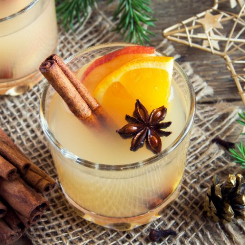 Hot toddy drink (apple orange rum punch) for Christmas and winter holidays