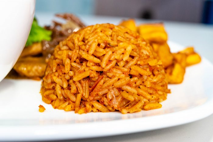 Jollof rice dome in a white plate