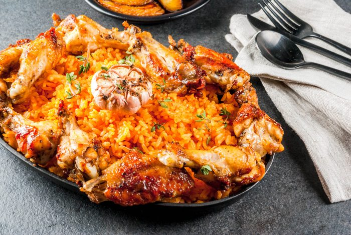 West African national cuisine such as jollof rice with grilled chicken wings and fried bananas plantains