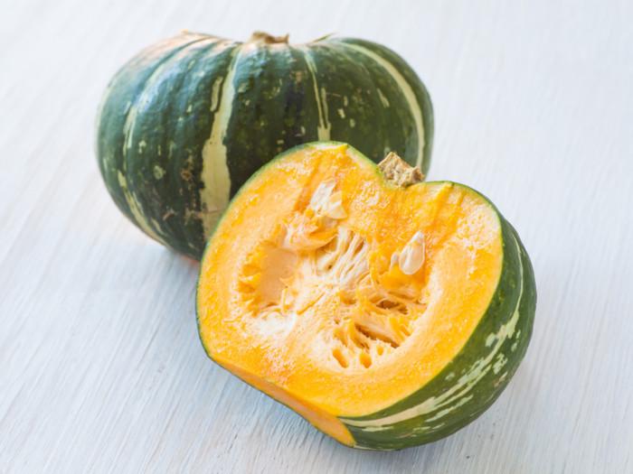 a close up shot of kabocha squash fruit cut into half