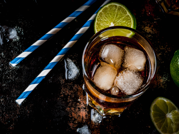 Long island or iced tea cocktails with hard liquor, cola, lime and ice