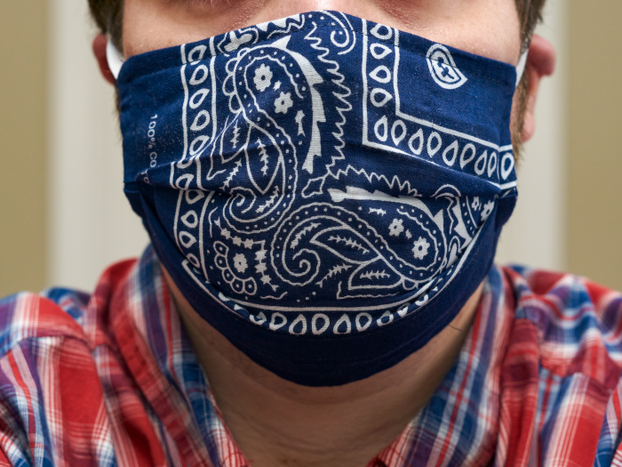 Woman in a homemade bandana face mask.