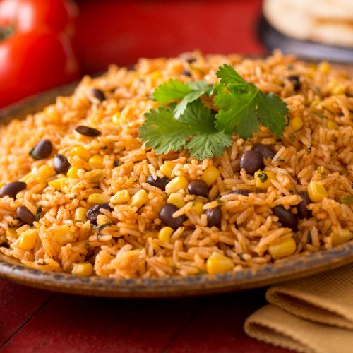 A plate of delicious authentic Mexican Rice with black beans, corn, garlic, and cilantro