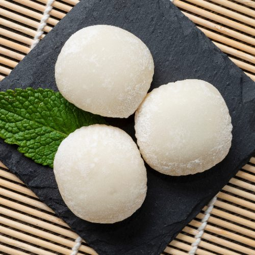 Japanese mochi ice cream with mint leaves on the wooden mat