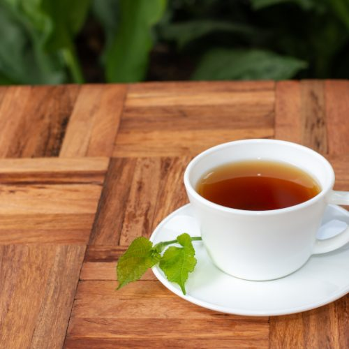 Mulberry leaf tea in a cup placed on a wooden counter