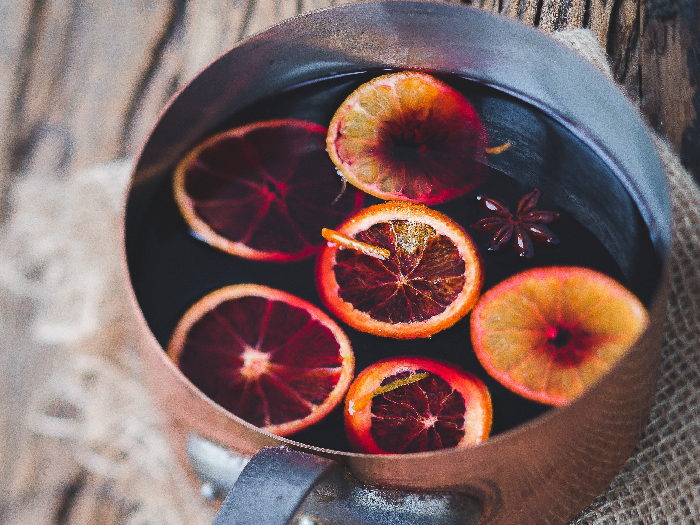 A flat lay pic of Christmas mulled wine in a saucepan