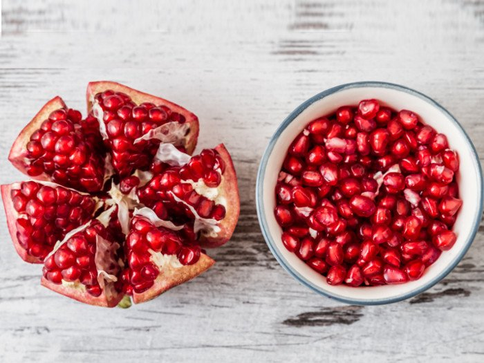 Freshly cleaned pomegranate seeds in a bowl