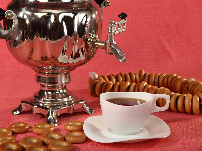 Russian samovar with bagels and cups of tea