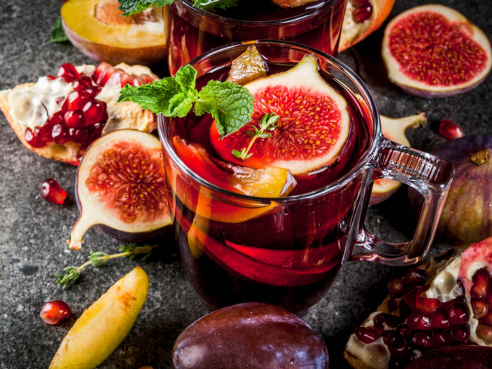 Sangria with figs, peaches, pomegranate, plums, and mint