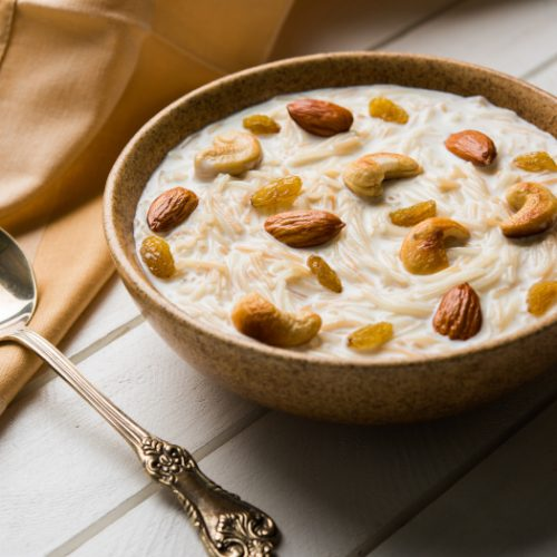 Sheer khurma or cooked vermicelli filled in a bowl with dry fruit toppings