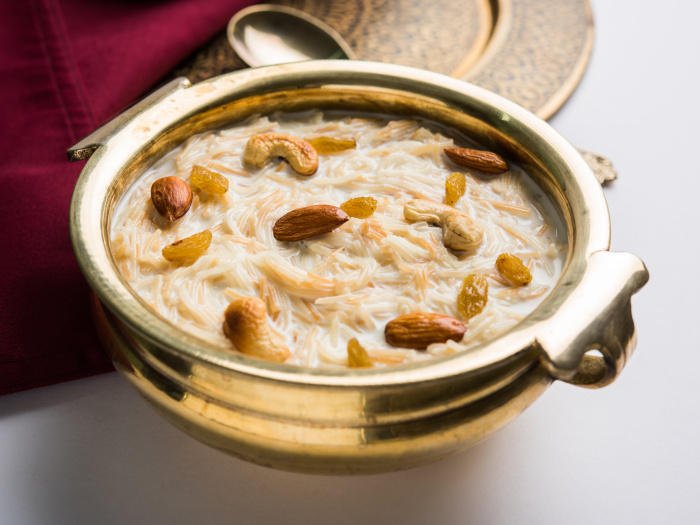 Sheer khurma in a bowl with dry fruit toppings