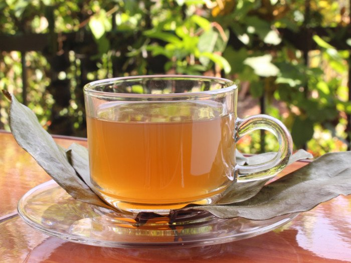 A cup of tea with dried leaves