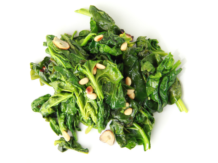 Spinach with garlic on a white background