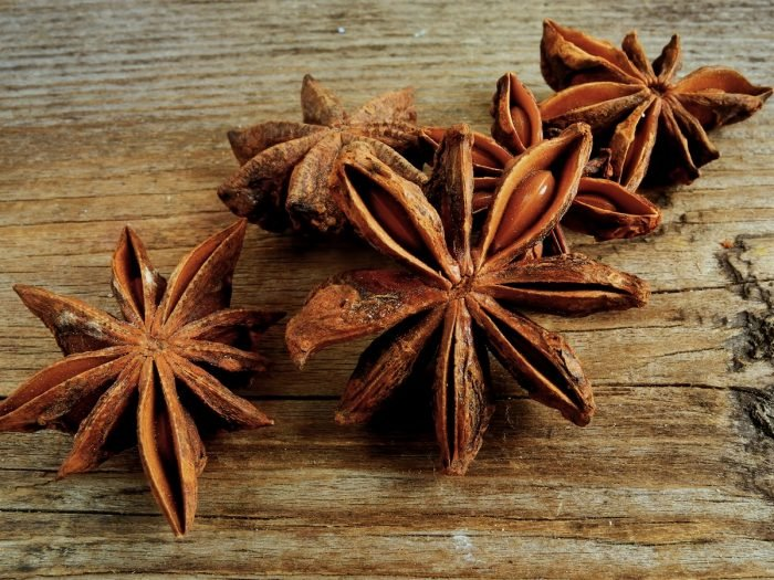 Star anise pods on a wooden table