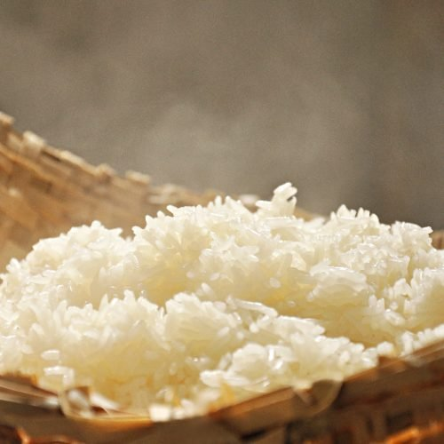 Hot sticky rice in old wooden steamer
