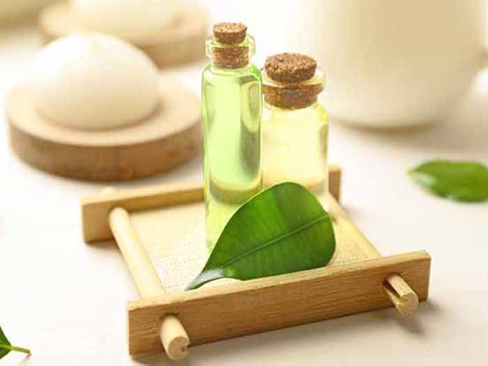 Tea tree oil bottles kept atop a wooden tray