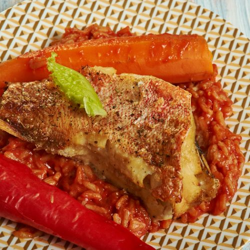 Senagal traditional dish, Thieboudienne or chebu jen, made from fish, rice and tomato sauce