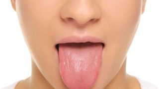 Tingling Tongue: Causes & Symptoms