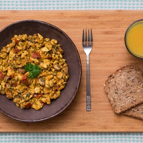 Vegan Spicy Scrambled Tofu with Mushrooms and Tomatoes, served with Multi-Grain Bread